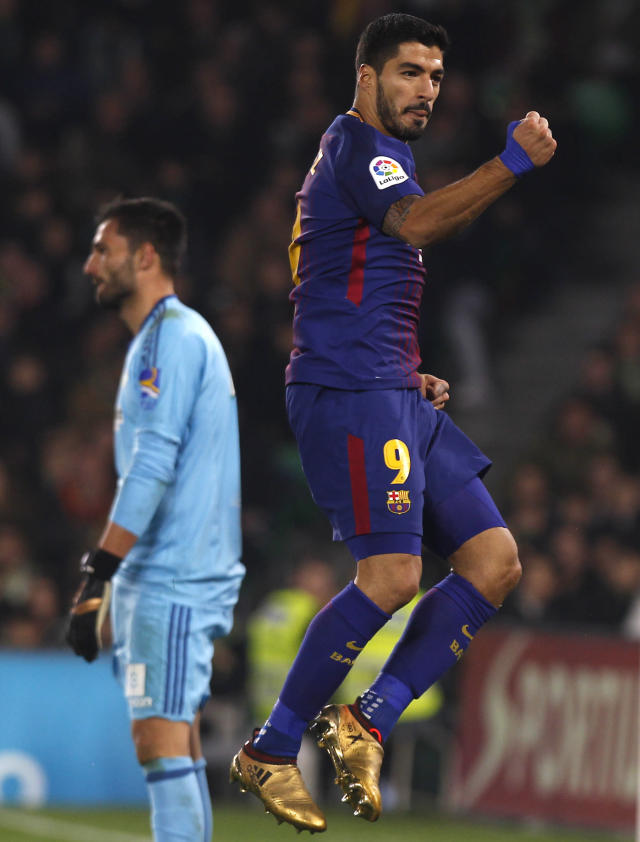 Barcelona's Suarez reacts after scoring against Betis during the La Liga soccer match between Barcelona and Betis at the Villamarin stadium, in Seville, Spain on Sunday, Jan. 21, 2018. (AP Photo/Miguel Morenatti)