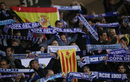 Soccer Football - Spanish King's Cup - Espanyol vs FC Barcelona - Quarter-Final - First Leg - RCDE Stadium, Barcelona, Spain - January 17, 2018 Espanyol fans hold up scarves and display Catalonia and Spain flags REUTERS/Albert Gea