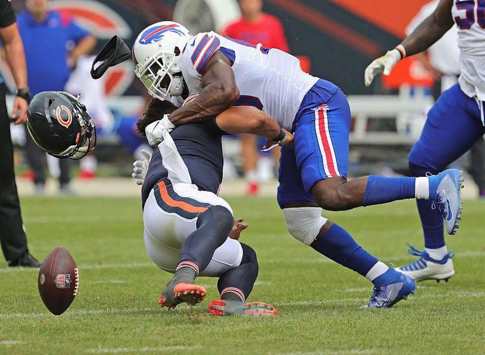 Justin Fields #1 of the Chicago Bears is hit by Andre Smith #59 of the Buffalo Bills  during a preseason game at Soldier Field on August 21, 2021 in Chicago, Illinois. The Bills defeated the Bears 41-15.