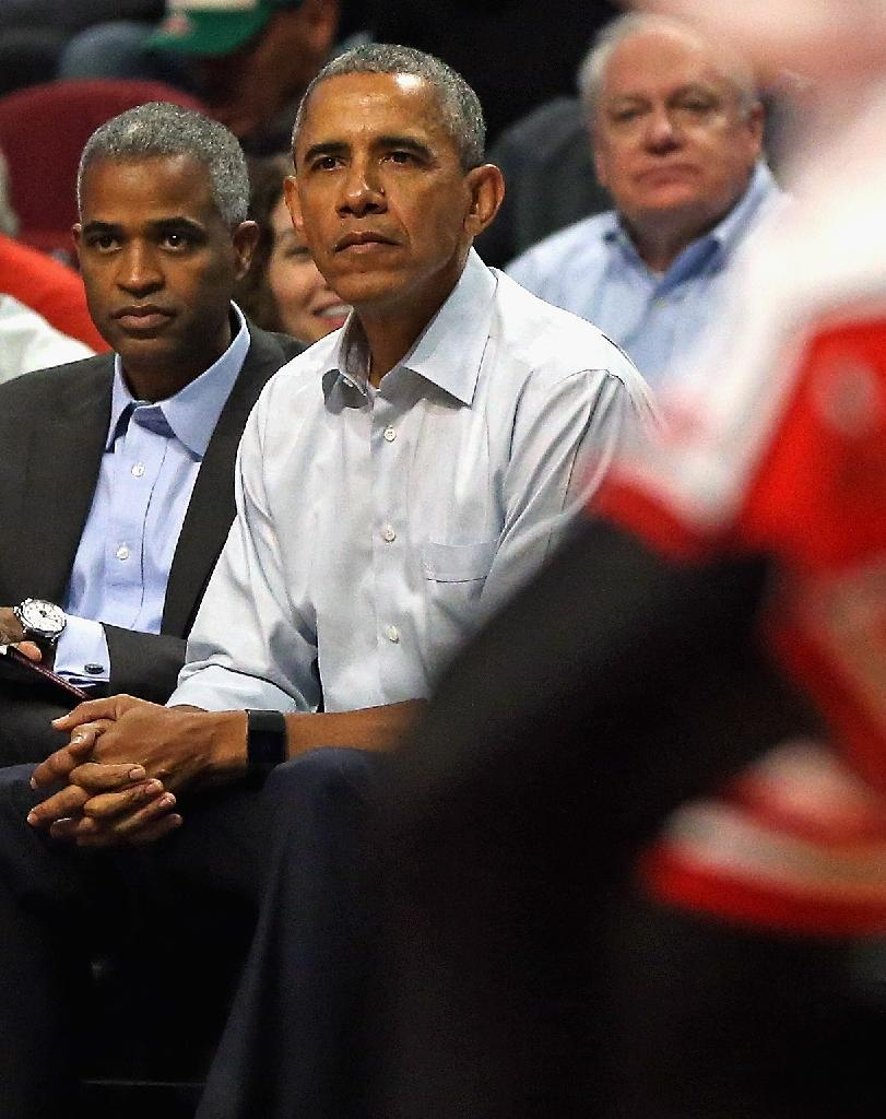 US President Barack Obama sits courtside as the Chicago Bulls take on the Cleveland Cavaliers during the season opening game at United Center on October 27, 2015 (AFP Photo/Jonathan Daniel)