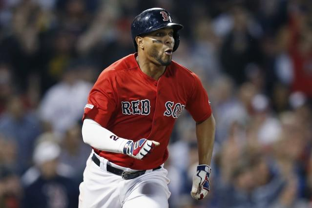 Boston Red Sox's Xander Bogaerts watches his RBI-double during the seventh inning of a baseball game against the Toronto Blue Jays in Boston, Friday, June 21, 2019. (AP Photo/Michael Dwyer)