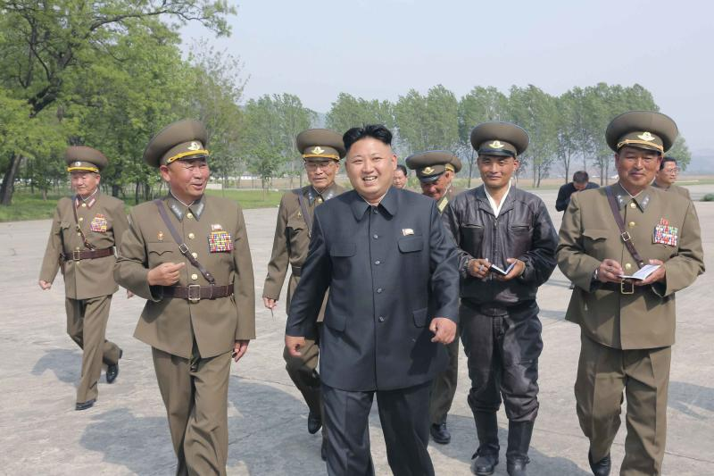 KCNA picture shows North Korean leader Kim Jong Un walking with officials during his inspection of Korean People's Army Air and Anti-Air Force Unit 447