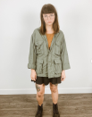 """<p>Shop your closet for a few staples—an orange tee, a utility jacket, a black skirt, and a pair of boots—to transform yourself into Daria.</p><p><a class=""""link rapid-noclick-resp"""" href=""""https://www.amazon.com/Military-Buttons-Lightweight-Utility-Outwear/dp/B087G8YHK7?tag=syn-yahoo-20&ascsubtag=%5Bartid%7C10072.g.37059504%5Bsrc%7Cyahoo-us"""" rel=""""nofollow noopener"""" target=""""_blank"""" data-ylk=""""slk:SHOP JACKET"""">SHOP JACKET</a></p>"""