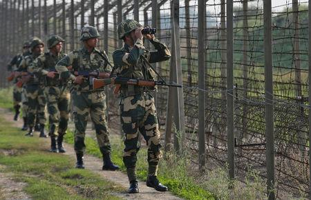 India's Border Security Force (BSF) soldiers patrol along the fenced border with Pakistan in Ranbir Singh Pura sector near Jammu February 26, 2019. REUTERS/Mukesh Gupta