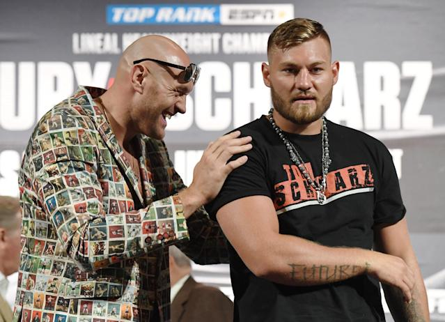 Tyson Fury (L) and Tom Schwarz pose during a news conference at MGM Grand Hotel & Casino on June 12, 2019, in Las Vegas. (Ethan Miller/Getty Images)