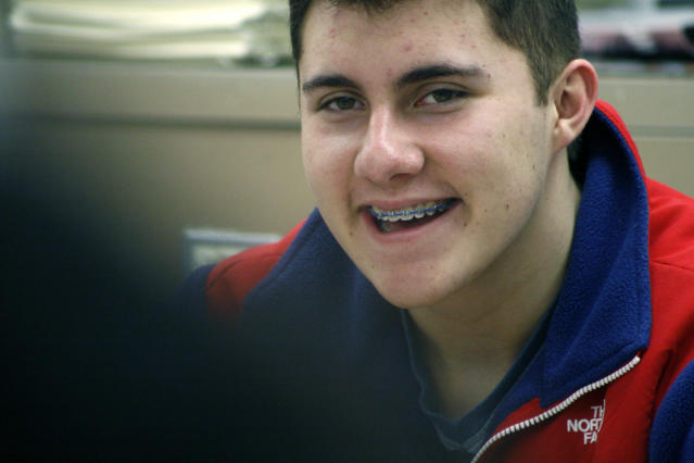 Brody Roybal, 15, smiles during a Spanish class at West Leyden High School in Northlake, Ill. on Tuesday, Feb. 11, 2014. Roybal, a sophomore, is the youngest member of the U.S. Paralympic sled hockey team which will play in Sochi, Russia in March 2014. (AP Photo/Martha Irvine)
