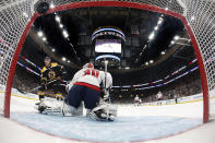 Boston Bruins' Charlie Coyle scores a shorthanded goal on Washington Capitals goaltender Ilya Samsonov during the second period of an NHL hockey game Monday, Dec. 23, 2019, in Boston. (AP Photo/Winslow Townson)