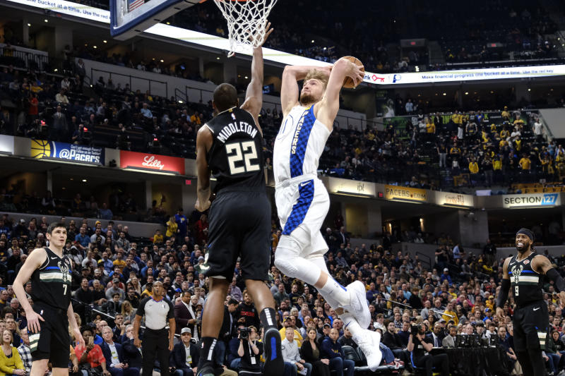 Indiana Pacers forward Domantas Sabonis (11) goes up to the basket as Milwaukee Bucks forward Khris Middleton (22) defends during the first half of an NBA basketball game in Indianapolis, Wednesday, Feb. 12, 2020. (AP Photo/AJ Mast)