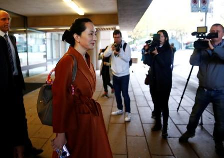 Huawei Technologies Chief Financial Officer Meng Wanzhou holds a Huawei cellphone as she leaves for a lunch break during a hearing at British Columbia supreme court in Vancouver