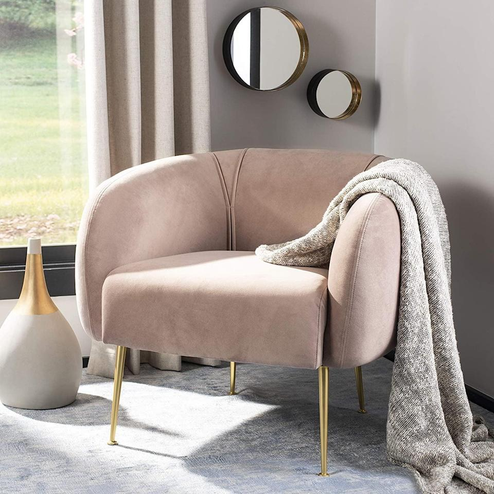 <p>Take your zoom calls on this stylish <span>Safavieh Couture Home Alena Mid-Century Pale Mauve and Gold Accent Chair</span> ($502, originally $1,058). It's perfect for filling out that random corner that feels too empty. </p>