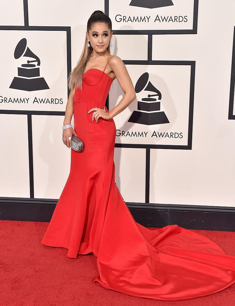 <p>Ariana Grande's gorgeous vermillion gown by Romona Keveza at the 2016 Grammy Awards made her the red carpet winner of the night. (Image via Getty Images)</p>