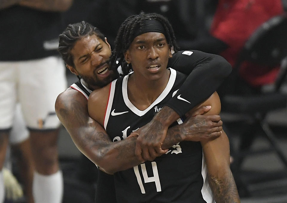 Paul George hugs Terance Mann, who scored 39 points to power the Los Angeles Clippers past the Utah Jazz in Game 6 of the Western Conference semifinals in Los Angeles on June 18, 2021. (Kevork Djansezian/Getty Images)