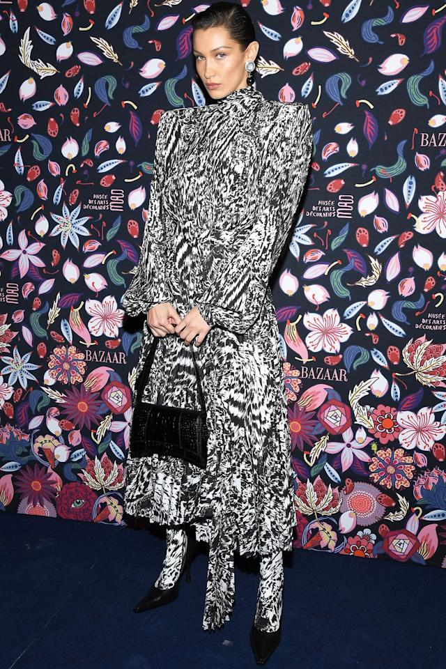 <p>Who: Bella Hadid </p><p>When: February 26, 2019</p><p>Wearing: Balenciaga</p><p>Why: Seen at Harper's Bazaar Exhibition party in Paris, France, Bella Hadid dressed like an '80s soap opera star who would definitely slap us in the face, then follow it up by pouring an extra dry martini on our head. That's OK, we probably deserved it. </p>