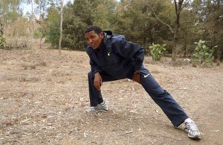 Eritrea's long-distance runner Zersenay Tadesse stretches after his training session in the capital Asmara, May 21, 2009. REUTERS/Andrew Cawthorne