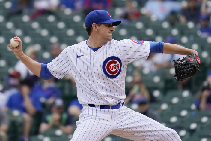 Chicago Cubs starting pitcher Kyle Hendricks throws against the Milwaukee Brewers during the first inning of a baseball game in Chicago, Wednesday, April 7, 2021. (AP Photo/Nam Y. Huh)