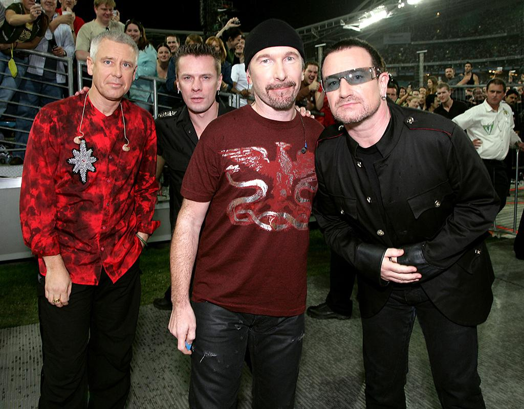 SYDNEY, AUSTRALIA - NOVEMBER 10: (UK TABLOID NEWSPAPERS OUT. EXCLUSIVE) (L-R) Adam Clayton, Larry Mullen Jr, The Edge and Bono of U2 walk to the stage ahead of their concert at the first of three rescheduled Sydney dates on their Vertigo Tour, at the Telstra Stadium on November 10, 2006 in Sydney, Australia. U2 have toured Australia four times in 1984, 1989, 1993 and 1998. The Vertigo 2005 Tour covered Europe and North America, with The Vertigo 2006 Tour taking in Mexico, South America, New Zealand Japan and Australia. The band has released 14 albums, selling 120 million worldwide. (Photo by Dave Hogan/Getty Images)