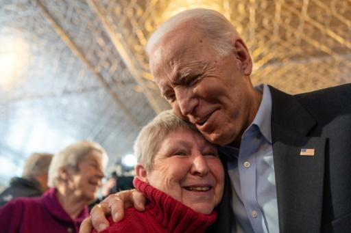 Democratic White House hopeful candidate Joe Biden, the former vice president, greets a voter during a campaign event on January 31, 2020 in Burlington, Iowa