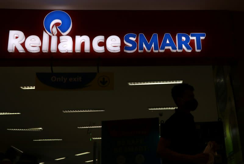 A man leaves a Reliance supermarket in Mumbai
