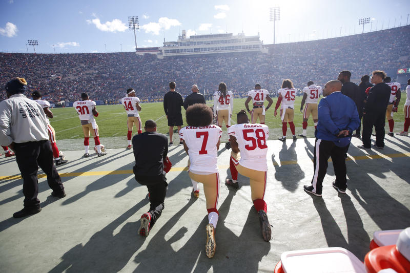 LOS ANGELES, CA - DECEMBER, 24: Eric Reid #35, Colin Kaepernick #7 and Eli Harold #58 of the San Francisco 49ers kneel on the sideline, during the anthem, prior to the game against the Los Angeles Rams at the Los Angeles Coliseum on December 24, 2016 in Los Angeles, California. The 49ers defeated the Rams 22-21. (Photo by Michael Zagaris/San Francisco 49ers/Getty Images)