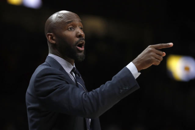 Atlanta Hawks head coach Lloyd Pierce directs his players on the court in the first half of an NBA basketball game against the Phoenix Suns Tuesday, Jan. 14, 2020, in Atlanta. (AP Photo/John Bazemore)