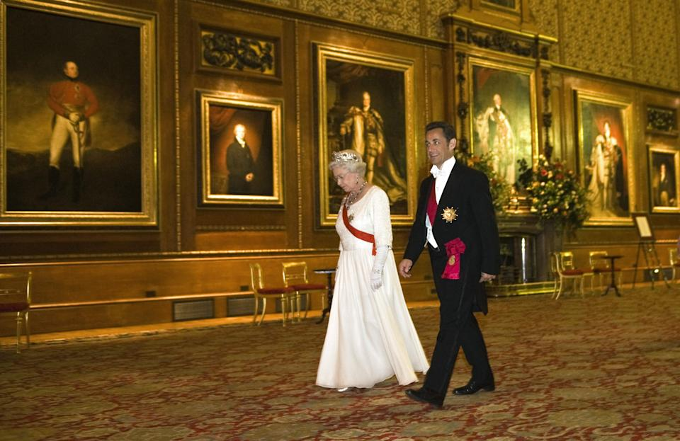 WINDSOR, ENGLAND - MARCH 26: (NO PUBLICATION IN UK MEDIA FOR 28 DAYS) Queen Elizabeth II hosts a State Banquet for President Nicolas Sarkozy at Windsor Castle on the first day of his State Visit on March 26, 2008 in Windsor, England. (Photo by POOL/ Tim Graham Picture Library/Getty Images)
