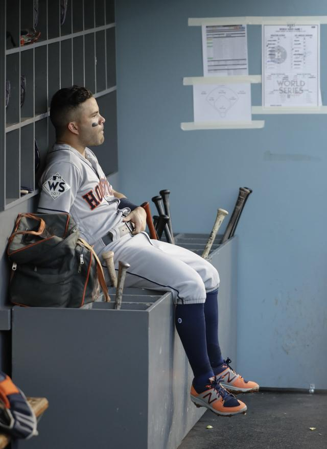 <p>Houston Astros' Jose Altuve sits in the dugout during the second inning of Game 1 of baseball's World Series against the Los Angeles Dodgers Tuesday, Oct. 24, 2017, in Los Angeles. (AP Photo/David J. Phillip) </p>