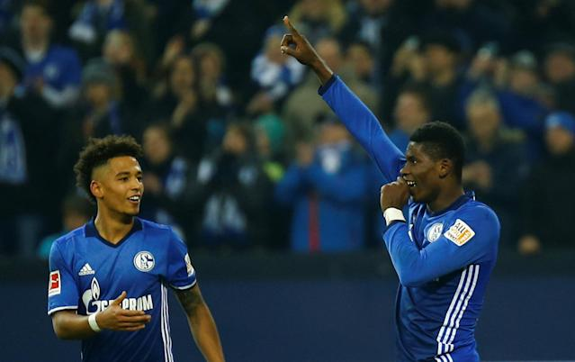 Soccer Football - Bundesliga - Schalke 04 vs TSG 1899 Hoffenheim - Veltins-Arena, Gelsenkirchen, Germany - February 17, 2018 Schalke's Breel Embolo celebrates with Thilo Kehrer after scoring their second goal REUTERS/Leon Kuegeler DFL RULES TO LIMIT THE ONLINE USAGE DURING MATCH TIME TO 15 PICTURES PER GAME. IMAGE SEQUENCES TO SIMULATE VIDEO IS NOT ALLOWED AT ANY TIME. FOR FURTHER QUERIES PLEASE CONTACT DFL DIRECTLY AT + 49 69 650050
