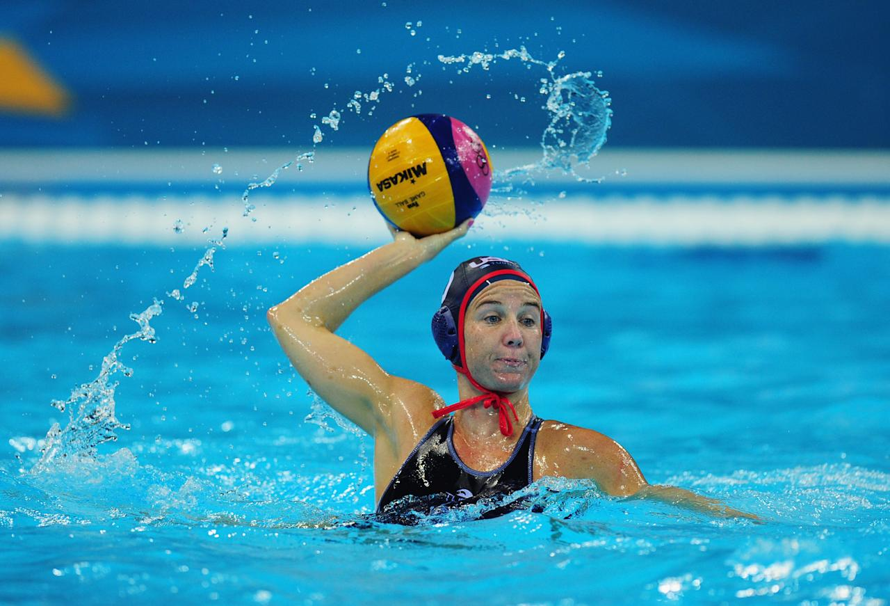 LONDON, ENGLAND - JULY 30:  Kelly Rulon of the United States looks for a pass during the Women's Water Polo Preliminary match between Hungary and the United States on Day 3 of the London 2012 Olympic Games at Water Polo Arena on July 30, 2012 in London, England.  (Photo by Stu Forster/Getty Images)
