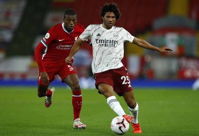 Arsenal midfielder Mohamed Elneny (right) is in quarantine following another positive Covid-19 test