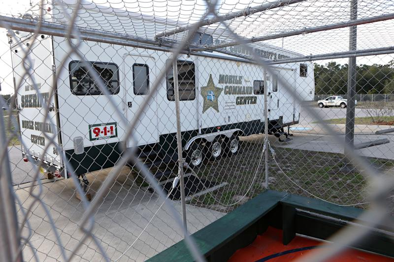 FILE - This March 5, 2014 file photo shows the Bay County Sheriff's Office Mobile Command Center through one of several containment units in Panama City Beach, Fla., a popular travel location for spring break revelers. (AP Photo/The News Herald/Panama City, Fla., Heather Leiphart)