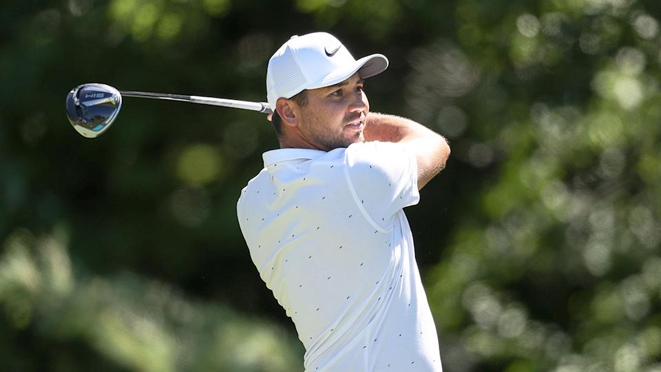 Jason Day is seen here watching a tee shot during a competitive round.