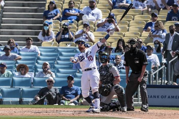 The Dodgers' Justin Turner connects for a solo homer in the sixth inning against the Nationals on April 9, 2021.