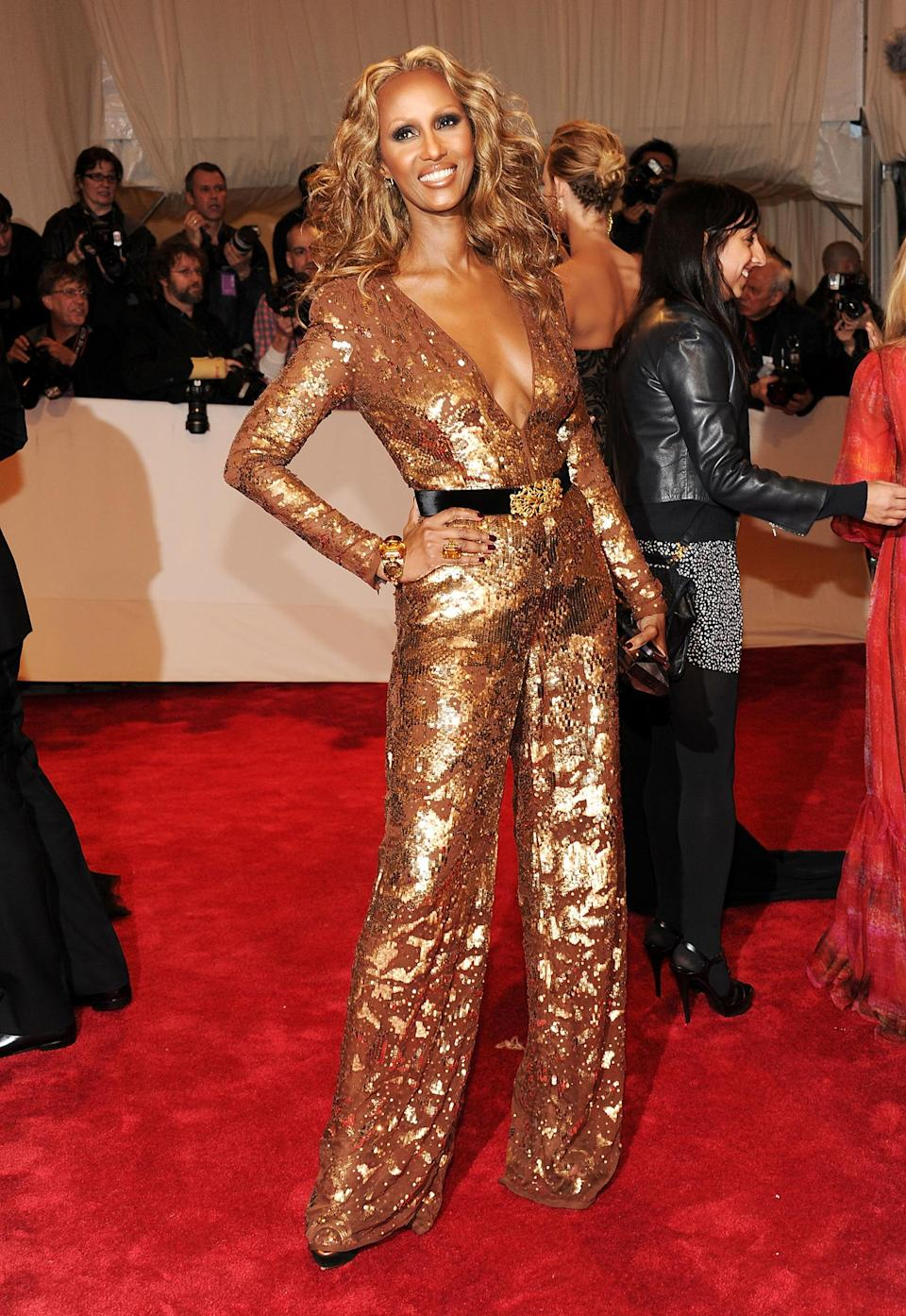 <p>Stella McCartney had a hand in creating this seriously sparkly jumpsuit for Iman's appearance at the 2011 Met Gala. (Photo: Larry Busacca/Getty Images) </p>