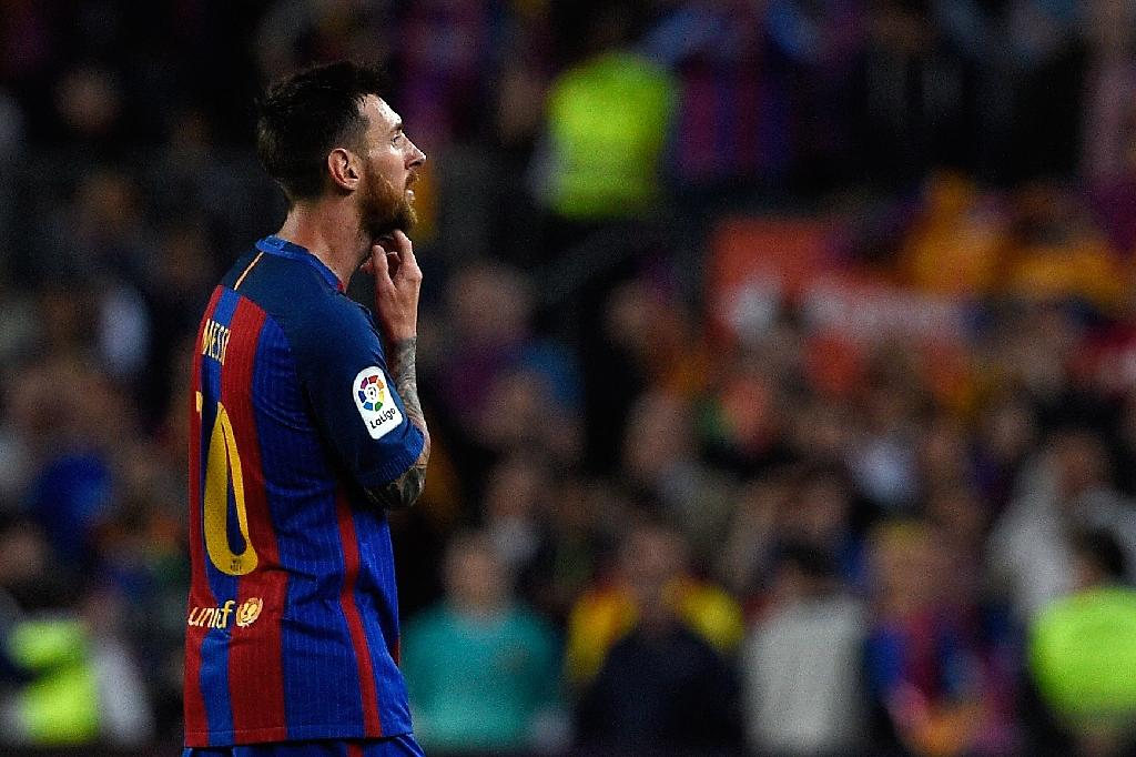 FC Barcelona's Argentine forward Messi was handed a 2.1-million-euro ($2.3 million) fine last year for avoiding paying taxes on part of the income he earned from image rights via companies in Belize, Britain, Switzerland and Uruguay (AFP Photo/LLUIS GENE)