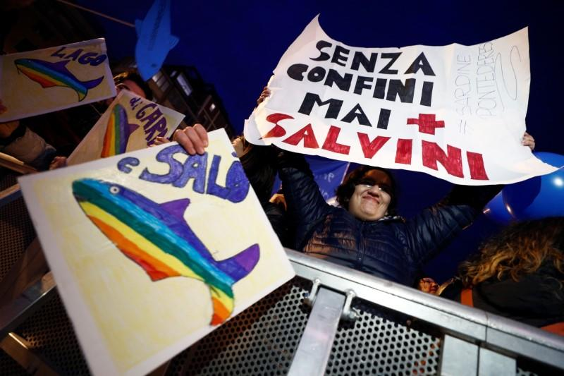 "Protesters attend a demonstration held by ""the sardines"", a grassroots movement against far-right League leader Matteo Salvini, in Bologna"