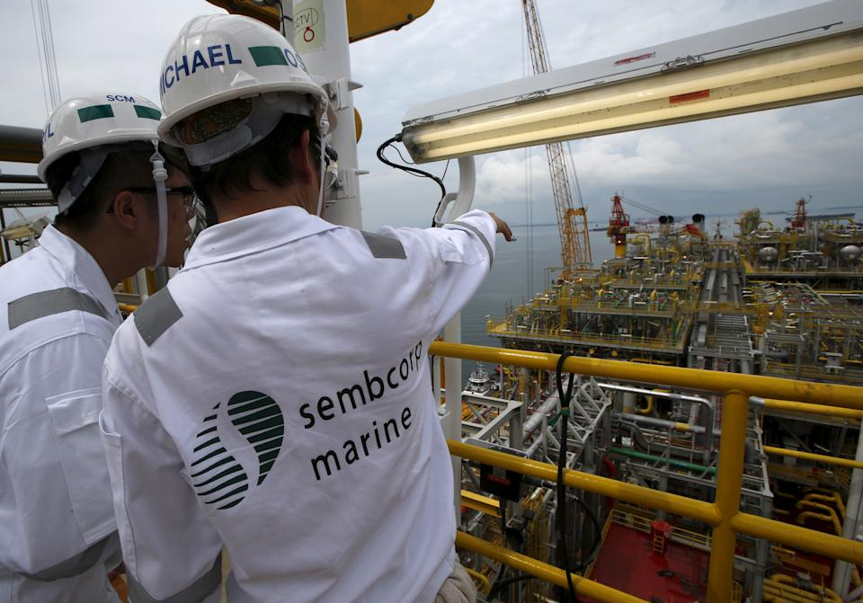 Sembcorp employees look at the modules on the main deck of Tullow Oil's newly completed Floating Production, Storage and Offloading vessel (FPSO) Prof. John Evans Atta Mills at Sembcorp Marine's Jurong Shipyard in Singapore January 20, 2016. Amid one of the deepest oil price crashes in history, Britain's Tullow Oil is sending one of the world's biggest floating deep-water oil production platforms to West Africa to pump crude for at least 20 years. Picture taken January 20, 2016.   REUTERS/Edgar Su