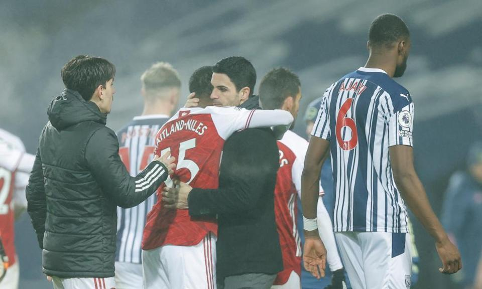 Mikel Arteta hugs Ainsley Maitland-Niles after Arsenal's 4-0 win at the Hawthorns in January.