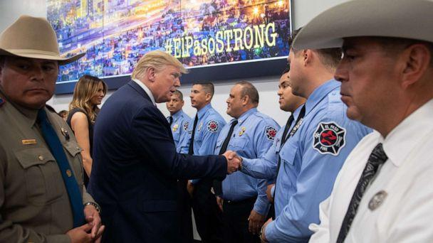 PHOTO: US President Donald Trump greets first responders as he visits El Paso Regional Communications Center in El Paso, Texas, August 7, 2019. (Saul Loeb/AFP/Getty Images)