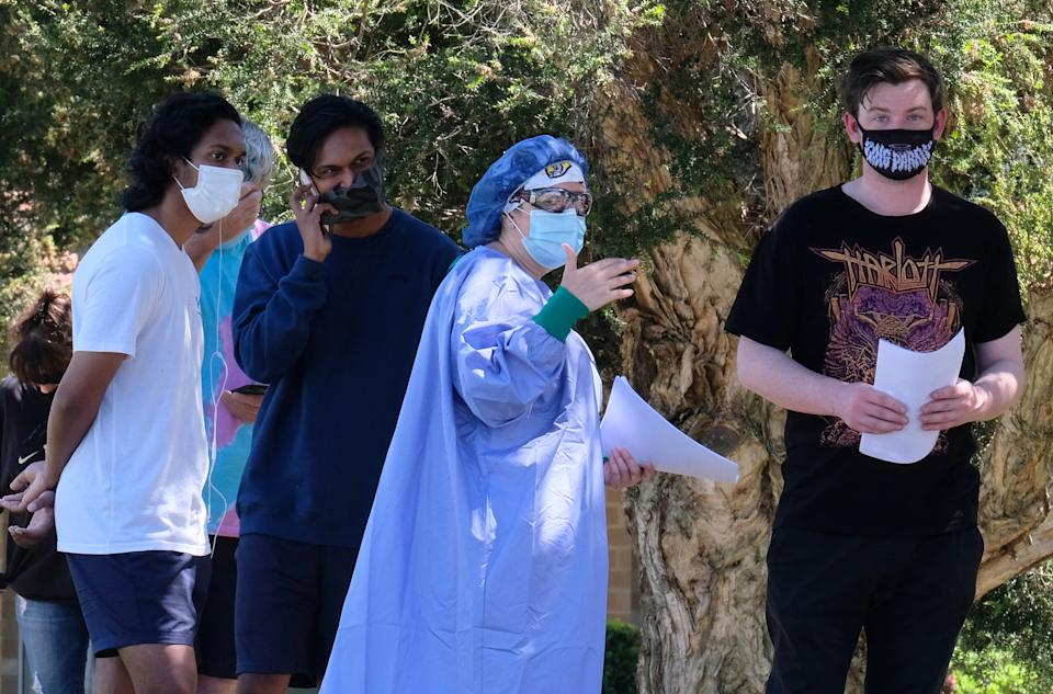 People line up as they wait to be tested for Covid at the Sunbury Respiratory Clinic in Melbourne. Source: AAP