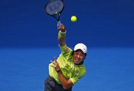Nishikori of Japan serves to Almagro of Spain during their men's singles match at the Australian Open 2015 tennis tournament in Melbourne