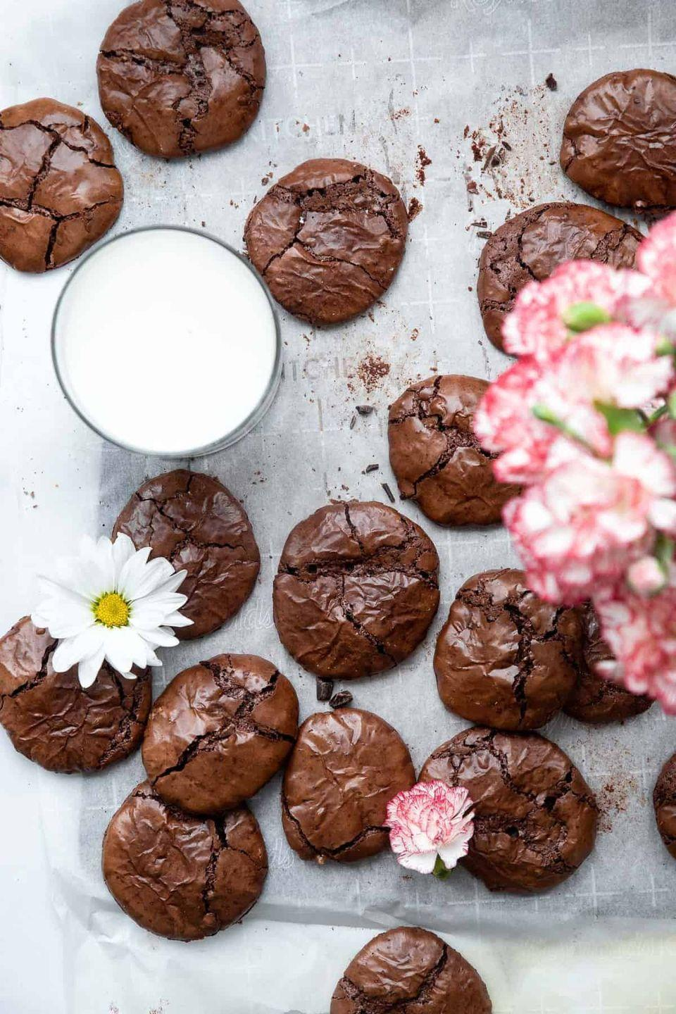 """<p>These are everything you love about chewy, chocolatey brownies—in cookie form! Best of all, they're made without any flour so they're gluten-free. </p><p><strong>Get the recipe at <a href=""""https://www.foodfaithfitness.com/flourless-gluten-free-chocolate-cookies/?web=1&wdLOR=c246A7DDC-87FC-2444-8F22-147DB37F9695"""" rel=""""nofollow noopener"""" target=""""_blank"""" data-ylk=""""slk:Food Faith Fitness"""" class=""""link rapid-noclick-resp"""">Food Faith Fitness</a>.</strong></p>"""