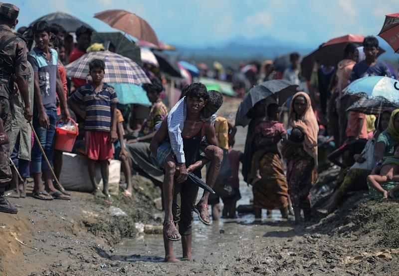 Impoverished, overcrowded Bangladesh is now home to nearly a million Rohingya refugees, the majority of whom have arrived in less than two months (AFP Photo/MUNIR UZ ZAMAN)