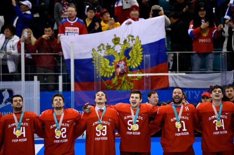 The Olympic Athletes from Russia sing the national anthem after receiving the gold medal for ice hockey. The team were welcomed home as heroes in Moscow Monday
