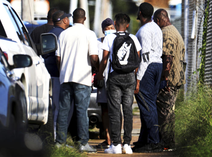 Family members of victims and employees pray outside of a post office after a shooting, Tuesday, Oct. 12, 2021 in the Orange Mound neighborhood of Memphis, Tenn. Police investigated a shooting Tuesday at a post office in an historic neighborhood of Memphis, Tennessee, the third high-profile shooting in the region in weeks.(Patrick Lantrip/Daily Memphian via AP)