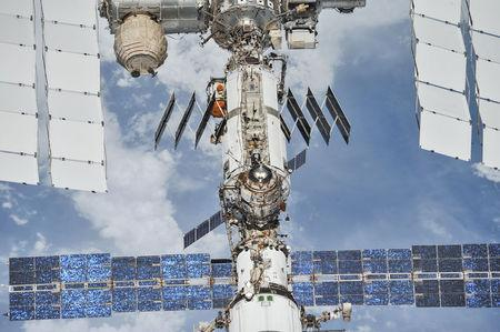 FILE PHOTO: Photo of the International Space Station (ISS) photographed by Expedition 56 crew members from a Soyuz spacecraft after undocking, Oct. 4, 2018. NASA/Roscosmos/Handout via REUTERS