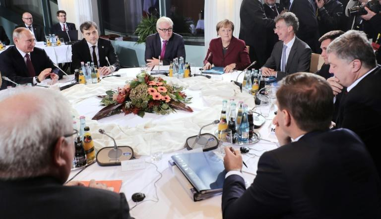 German Chancellor Angela Merkel hosting Russian President Vladimir Putin (l) and Ukrainian President Petro Poroshenko (2nd r) during the last 'Normandy Format' meeting in Berlin in October 2016