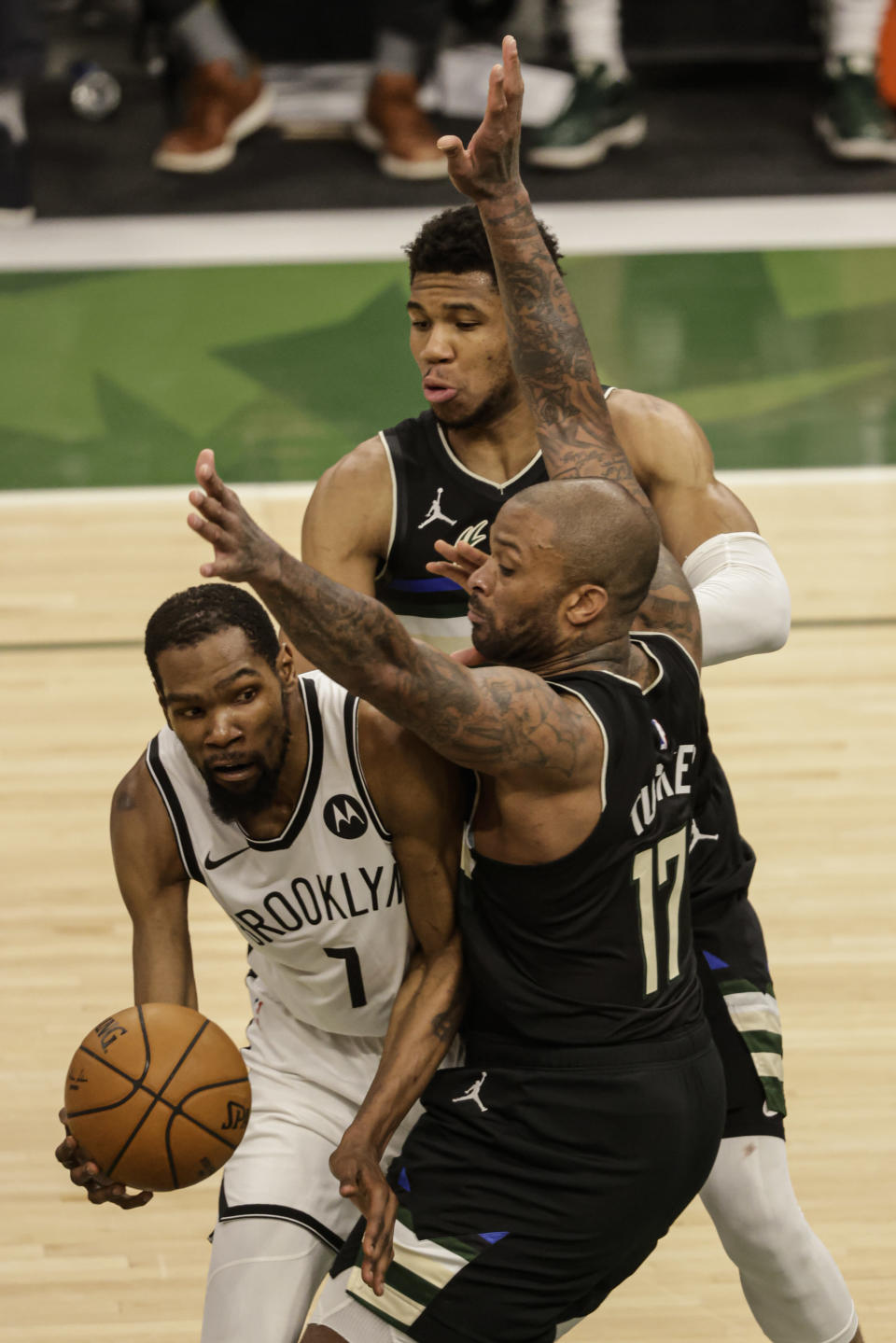 Brooklyn Nets' Kevin Durant (7) is guarded by Milwaukee Bucks forward P.J. Tucker (17) during the second half of Game 6 of a second-round NBA basketball playoff series Thursday, June 17, 2021, in Milwaukee. (AP Photo/Jeffrey Phelps)