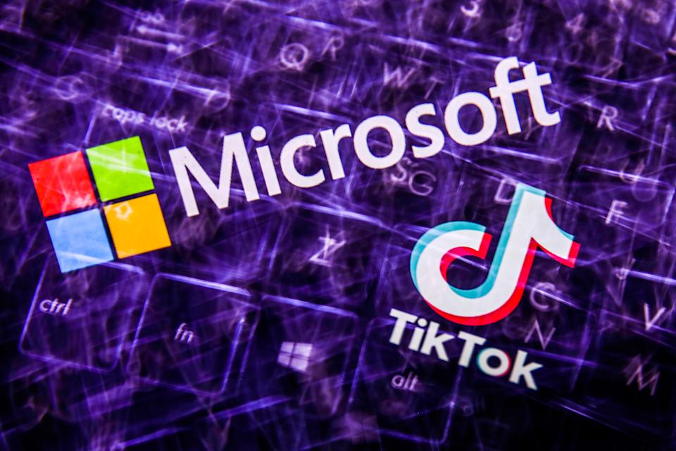 TikTok and Microsoft logos displayed on a screen and  keyboard are seen in this multiple exposure illustration photo taken on August 3, 2020. Microsoft is interested in purchase TikTok platform in the United States. (Photo Illustration by Jakub Porzycki/NurPhoto via Getty Images)