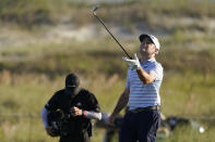 Louis Oosthuizen, of South Africa, tosses his club after a poor shot on the 18th hole during the second round of the PGA Championship golf tournament on the Ocean Course Friday, May 21, 2021, in Kiawah Island, S.C. (AP Photo/Chris Carlson)