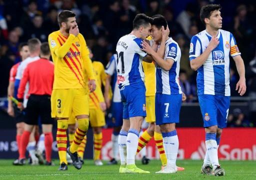 Espanyol players celebrate after Wu Lei's late equaliser against Barcelona in January. They have to beat their local rivals on Wednesday to delay their relegation